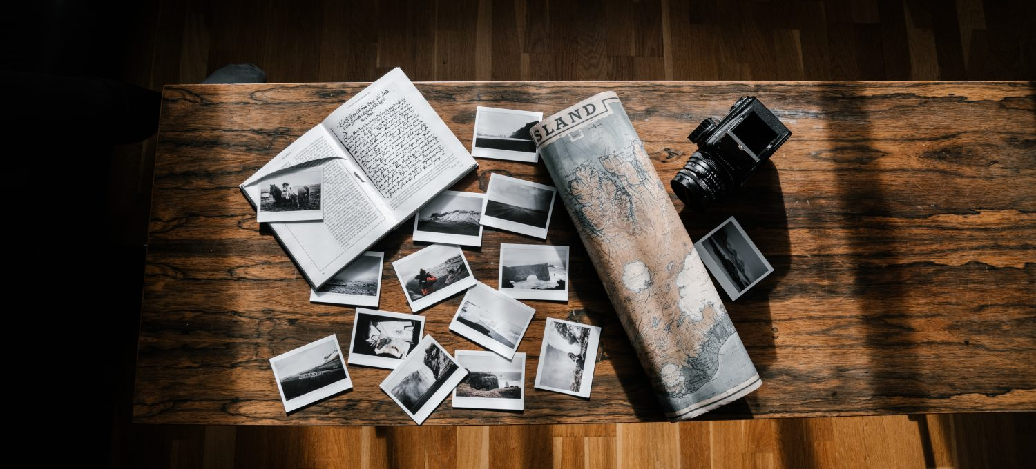 cropped-canva-photos-and-journal-with-map-and-camera-on-wooden-table.jpg